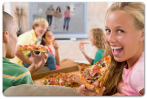 smiling blonde girl excited to eat pizza