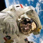 astronaut floats in outer space in front of earth
